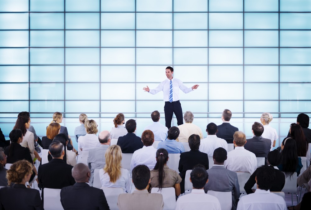 Businessman giving presentation to his Colleagues about viral events