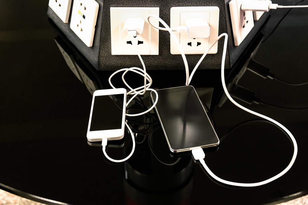 Charging station for mobile smart phones at international airport  - Helpful corner for electronical modern technology devices and smartphones