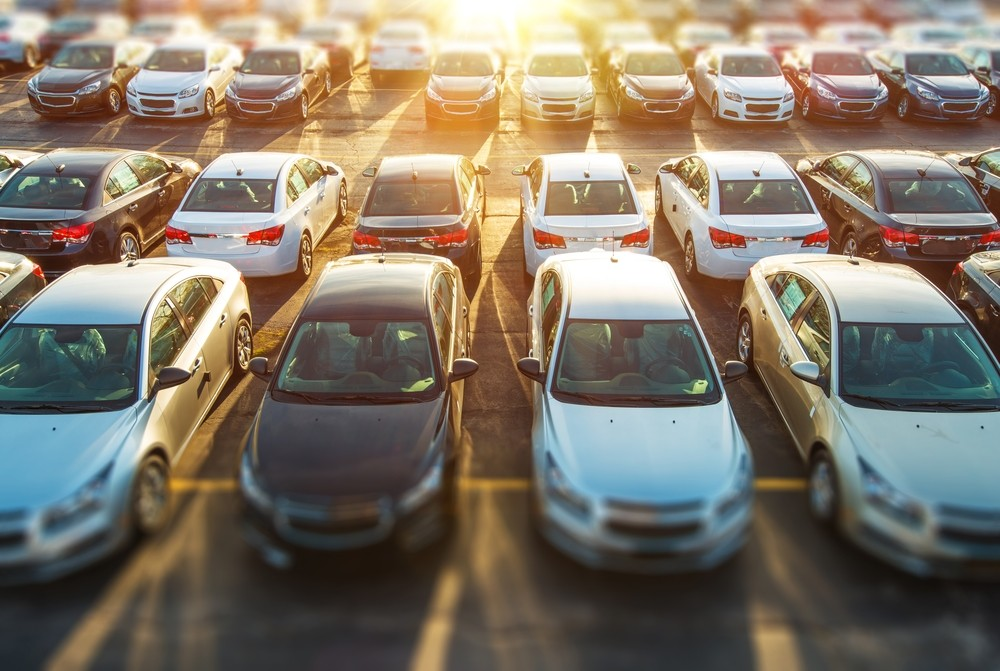 Dealer Vehicles in Stock. Brand New Cars Awaiting Clients on the Dealer Parking Lot. Priority Parking.